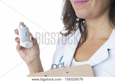 Close up of a female doctor is holding a pressurized cartridge inhaler and a clipboard - Cropped view - Isolated on a white background