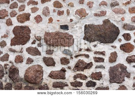 abstract spotty texture and background of a stone wall