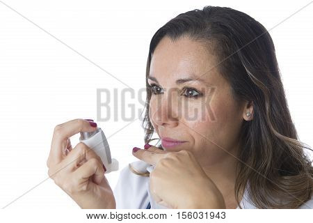 Female doctor is showing the distance of two fingers from the mouth to the pressurized cartridge inhaler - Isolated on a white background