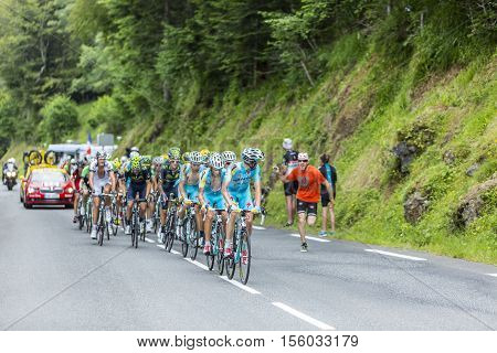 Col du Tourmalet France - July 242014: Astana Team in front of a part of the peloton climbing the road to Col de Tourmalet in the stage 18 of Le Tour de France 2014.
