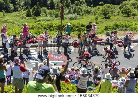 Pas de Peyrol France - July 62016: The cyclists Thomas De Gend of Lotto-Soudal Team and Greg Van Avermaet of BMC Racing Team in the breakaway riding on the road to Pas de Pyerol (Puy Mary) in Cantalin the Central Massif during the stage 5 of Tour de Franc