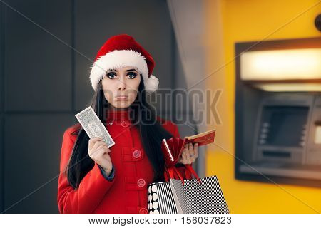 Christmas Woman Holding One Dollar in Front of an ATM