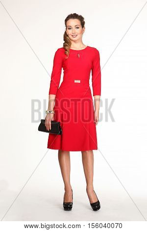 young brown plaited hair woman in red formal long sleeve dress and clutch full body length isolated on white