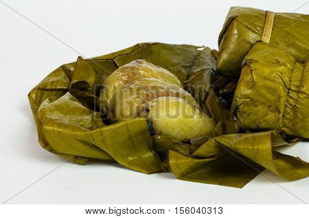Porridge tie. Sticky rice wrapped in banana leaves, banana banana filling, steamed cooked food.