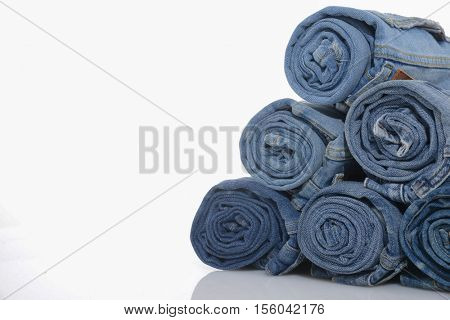 rolls of jeans, denim texture, composition, stack of denim pants