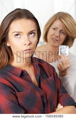 Mother Talking To Teenage Daughter About Contraception