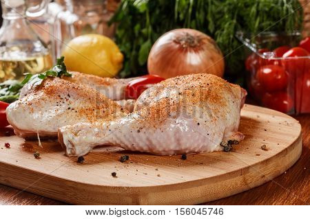 Raw Chicken Drumsticks Seasoned With Herbs