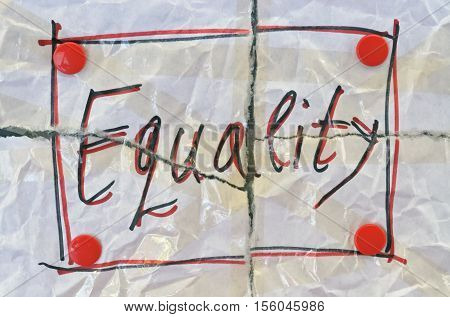 Word Equality written on torn white paper