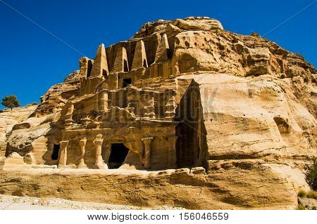 Photo of the Obelisk Tomb and Bab As-Siq Triclinium ruins ancient Nabataean city Petra, Jordan near entrance to canyon Siq. Explore and adventure concept.
