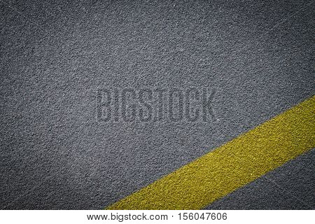 Asphalt road texture yellow line on road