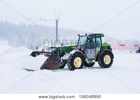 Kopaonik, Serbia - January 18, 2016: Tractor snowplow cleaning snow road during snowfall