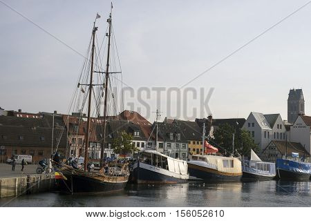 WISMAR GERMANY - OCTOBER 14 2016: Part of the old harbor in Wismar with fishmonger boats at dock. View from seaside. October 14 2016 Germany.
