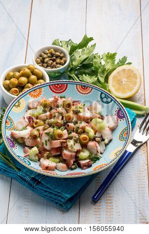 octopus salad with capers celery and green olives and lettuce