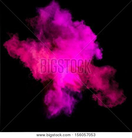 Freeze motion of purle dust explosion isolated on black background