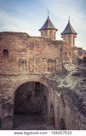 Romanian orthodox church. Orthodox church in Targovist Rromania. Ruins wall and orthodox church