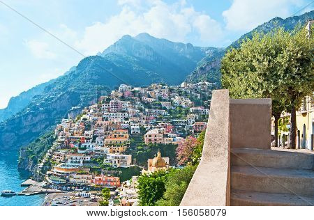 Positano resort boasts amazing views on the old town on the rock lush mediterranean gardens cozy beach nice cafes medieval Cathedral and numerous boats always ready for the trip Italy.