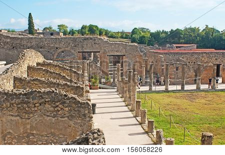 POMPEII ITALY - OCTOBER 4 2012: The ruins of gladiators' houses around the Quadriporch on October 4 in Pompeii.