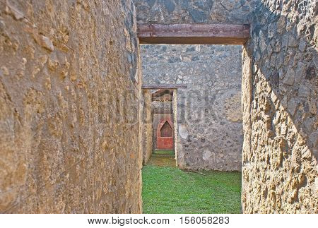 The preserved buildings in Pompeii archaeological site helps to discover the way of life in ancient Roman city Italy.