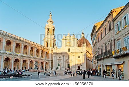 LORETO ITALY - OCTOBER 6 2012: The tourists and pilgrims in Square of Madonna with the view on the Basilica of Santa Casa on October 6 in Loreto.