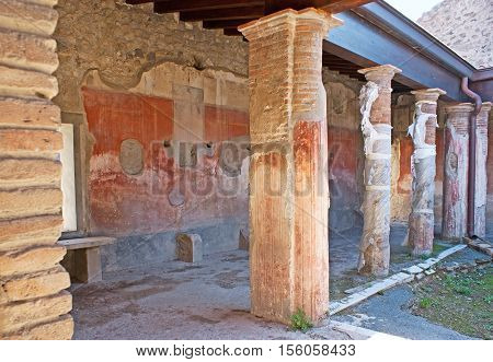 The remains of the painted decorations in the covered gallery of ancient Roman villa in Pompeii Italy.