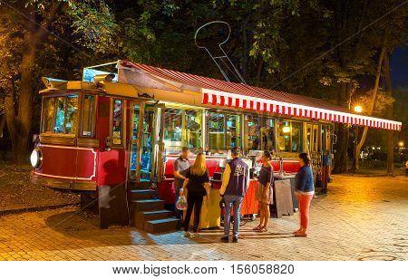 KIEV UKRAINE - SEPTEMBER 11 2016: The vintage tram in Taras Shevchenko park serves as the cafe offering snacks and beverages on September 11 in Kiev.