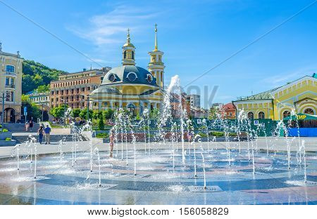 KIEV UKRAINE - SEPTEMBER 8 2016: The Rizdvo (Christmas) Church behind the fountain in Postal (Poshtova) Square in Podol district on September 8 in Kiev.