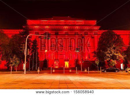 KIEV UKRAINE - SEPTEMBER 11 2016: The red building of National University of Taras Shevchenko boasts bright illumination making it the most colorful in city on September 11 in Kiev.