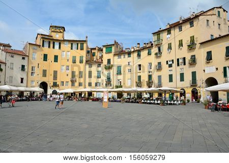 Lucca Italy - September 5 2016: Buildings on Piazza Napoleone square in old part of Lucca city in Italy. Unidentified people visible.