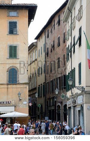 Lucca Italy - September 5 2016: Buildings and narrow street on Piazza San Michele square in old part of Lucca city in Italy. Unidentified people visible.