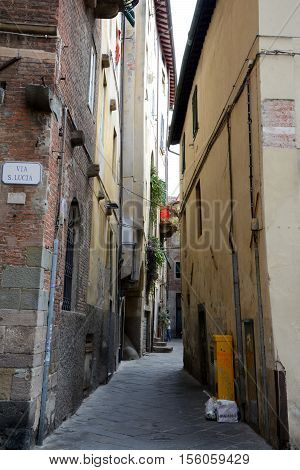 Lucca Italy - September 5 2016: Narrow street in old part of Lucca city in Italy. Unidentified people visible.