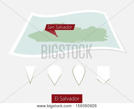 Curved Paper Map Of El Salvador With Capital San Salvador On Gray Background. Four Different Map Pin
