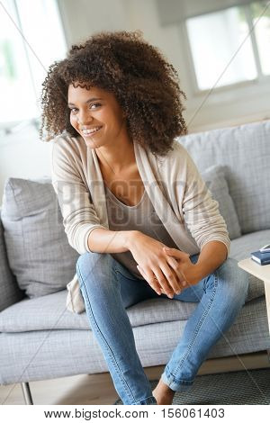 Beuatiful mixed race woman relaxing in sofa