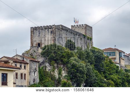 Medieval castle tower and Church of San Vicente de la Barquera Cantabria Spain