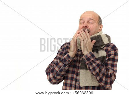 Suffering from flu virus sneezing. Elderly man is ill from colds or pneumonia.