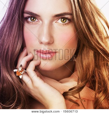 Beautiful woman with ring and salmon color scarf