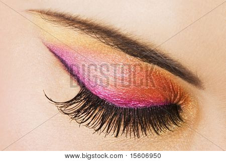 Woman eye with bright makeup
