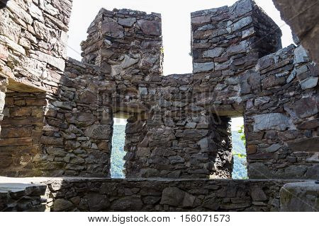 Ruins of ancient round stone guard tower with loopholes - inside view . Reichenstein Castle Rhine Valley Germany - UNESCO World Heritage