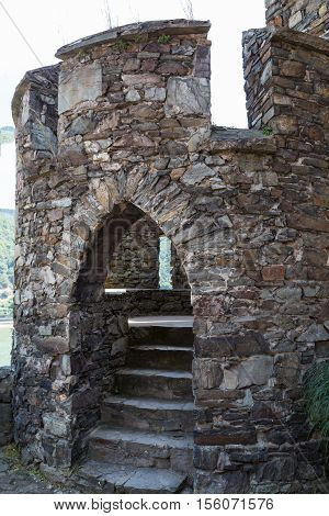 Ancient watchtower round stone tower with arched entrance and staircase. Reichenstein Castle Rhine Valley Germany - UNESCO World Heritage