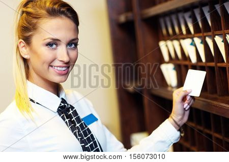 Picture of receptionist with key cards