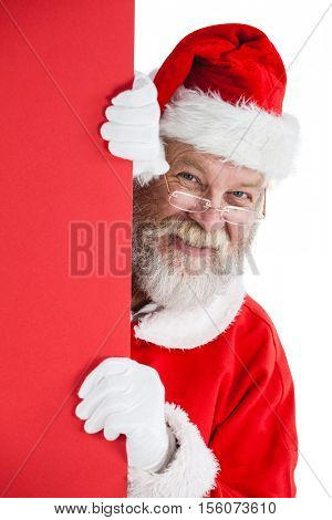 Santa claus peeking from red board against white background