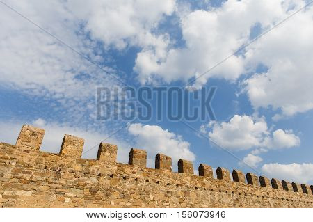 Russia. Crimea. Sudak. Genoese fortress against blue sky with clouds in summer .14.09.2016