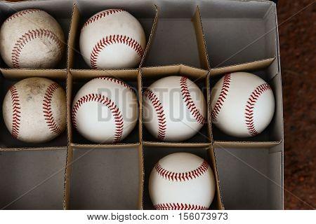 several baseballs in a box horizontal composition