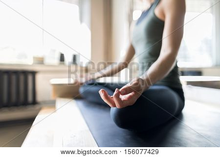 Woman Doing Yoga Exercises In Gym, Closeup Sport Fitness Girl Sitting Lotus Pose Meditation Relaxation