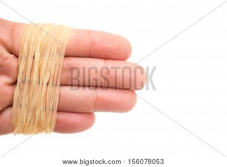 fingers wrapped by elastic loops on white background