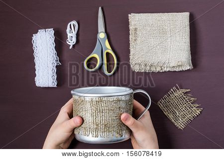 Burlap eco-decor. Homemade making of decor of burlap and lace for aluminum mug. DIY concept. Step by step photo instructions. Step 2. Attach to mug strip of burlap