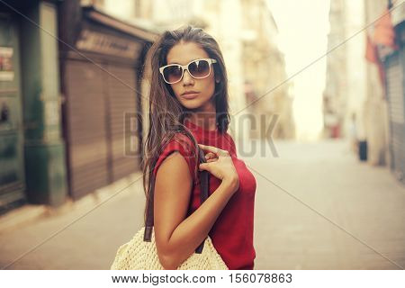Fashionable woman walking in the street