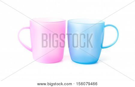 pink and blue plastic cups on a white background