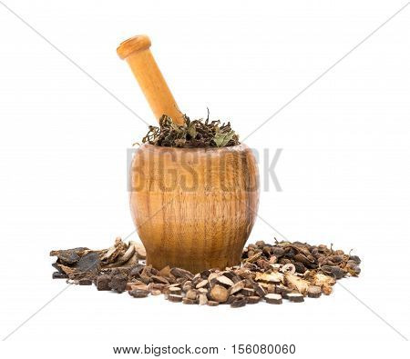 side view wooden mortar and pestle with herbs on a white background