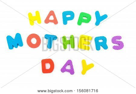 words of happy mothers day shaped by alphabet jigsaw puzzle on white