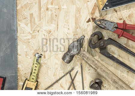 Tools Set On Osb Panel With Copy Space.  Carpenter Workplace On Wooden Background. Top View.